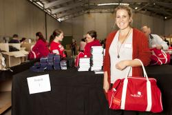 Hollie was working for FCm Travel Solutions in Perth when she was diagnosed with cancer and received a Support Pack from Redkite. Now cancer free, she happily helped out packing this year
